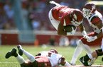 Arkansas running back Devwah Whaley is tackled by New Mexico State defensive back Jacob Nwanga during a game Saturday, Sept. 30, 2017, in Fayetteville.