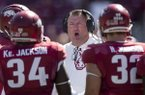 Bret Bielema, Arkansas head coach, talks to offensive players in the fourth quarter against New Mexico State Saturday, Sept. 30, 2017, at Razorback Stadium in Fayetteville.