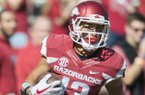 Arkansas Razorbacks wide receiver Deon Stewart (13) runs the ball for a touchdown during the first half of the game between Arkansas Razorbacks and New Mexico State Aggies on Saturday, September 30, 2017 at Razorback Stadium in Fayetteville.