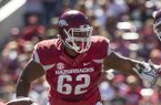 Arkansas offensive lineman Johnny Gibson blocks during a game against New Mexico State on Saturday, Sept. 30, 2017, in Fayetteville.