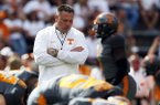 Tennessee head coach Butch Jones walks between his players before an NCAA college football game against Georgia, Saturday, Sept. 30, 2017, in Knoxville, Tenn. (AP Photo/Wade Payne)