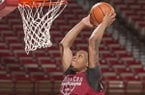 Arkansas guard Khalil Garland dunks the ball during practice Tuesday, Oct. 3, 2017, in Fayetteville.