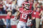 Arkansas receiver Deon Stewart reacts to scoring a touchdown during a game against New Mexico State on Saturday, Sept. 30, 2017, in Fayetteville.