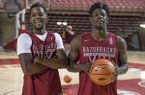 Arkansas guards Daryl Macon, left, and Jaylen Barford are shown during the Razorbacks' annual media day on Tuesday, Oct. 3, 2017, in Fayetteville.