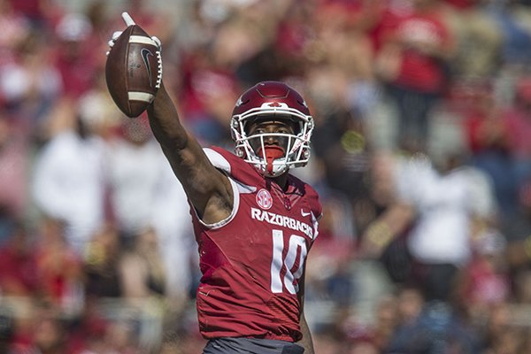Arkansas receiver Jordan Jones signals first down during a game against New Mexico State on Saturday, Sept. 30, 2017, in Fayetteville.