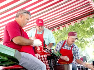 FILE PHOTO Volunteers stayed busy during the 2016 Arkansas Apple Festival, slicing apples and handing out free samples. Some of the volunteers included Josh Moore, Doug Hulse and Jerry McDonald.