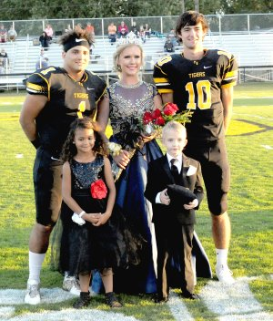 MARK HUMPHREY ENTERPRISE-LEADER 2017 Homecoming queen, Emily Smith, daughter of Doug and Christina Smith, escorted by captains of the game, Anthony Johnson (left), son of Andrea Harrel and Jamal Johnson; and John David Elder, son of John and Carla Elder; and attendants Anniyah Hood, daughter of Andrea Harrell and Lucas Hood; and Hunter Kidd, son of Doug and Cindi Kidd.