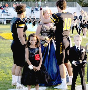 MARK HUMPHREY ENTERPRISE-LEADER Prairie Grove senior Emily Smith, daughter of Doug and Christina Smith, is crowned 2017 Homecoming queen by team captain John David Elder, while co-captain Anthony Johnson, looks on, and attendants Anniyah Hood, and Lucas Hood stand poised to do their part in the celebration.