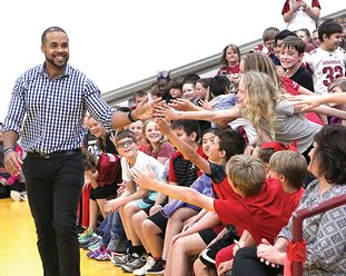 The Sentinel-Record/Richard Rasmussen RAZORBACK GREAT: Lake Hamilton Intermediate School students greeted television personality D.J. Williams, left, when he visited on Tuesday to speak about positive attitude and effort. Williams shared stories about his time as an All-American tight end for the Arkansas Razorbacks and playing in the NFL.