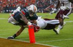 Auburn wide receiver Ryan Davis (23) dives past Mississippi State defensive back Johnathan Abram (38) into the end zone for a touchdown during the first half of an NCAA college football game Saturday, Sept. 30, 2017, in Auburn, Ala. Auburn won 49-10. (AP Photo/Butch Dill)