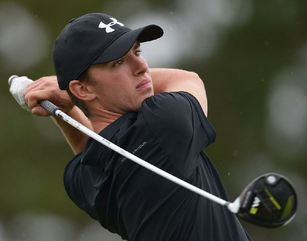 fayettevilles-fisher-vollendorf-follows-through-with-his-tee-shot-on-no-7-during-the-class-7a-state-golf-tournament-wednesday-at-fayetteville-country-club-vollendorfs-68-helped-lead-the-bulldogs-to-the-state-title