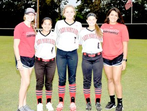Photo by Rick Peck McDonald County High School honored the senior members of the 2017 Lady Mustang softball team on Sept. 26 following McDonald County's 5-1 loss to Monett. From left to right: Meagan Mills (manager), Miryan Martinez, Kenzie Stephens, Cloee Helm and Rebekah Hitt (manager).