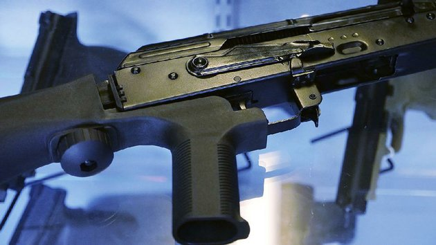 an-assault-rifle-with-a-bump-stock-device-is-displayed-thursday-at-the-gun-vault-store-and-shooting-range-in-south-jordan-utah