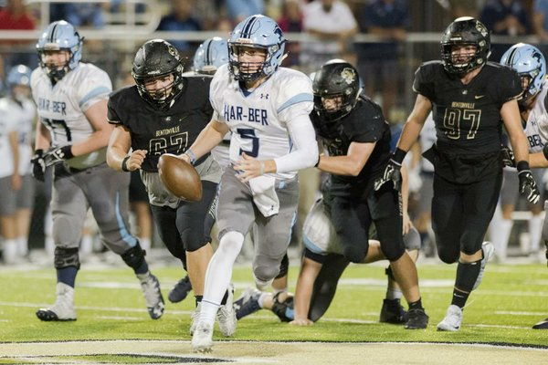 NWA Democrat-Gazette/CHARLIE KAIJO Springdale Har-Ber High School quarterback Grant Allen (5) runs the ball in the final quarter during a football game between Springdale Har-Ber High School on Friday, October 6, 2017 at Bentonville High School in Bentonville.
