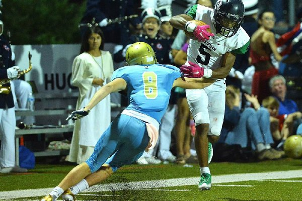Little Rock Christian wide receiver Justice Hill jukes Pulaski Academy defender Luke Bratcher (8) during Friday night's game against at Joe B. Hatcher stadium in Little Rock.  Special to the Democrat-Gazette/JIMMY JONES