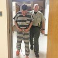 Charles Alan Rickman, 30, of Siloam Springs is led Friday into a courtroom at the Benton County Cour...