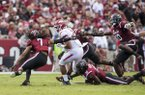 Chase Hayden (2), Arkansas running back, tries to evade a host of South Carolina defenders in the second quarter Saturday, Oct. 7, 2017, at Williams-Brice Stadium in Columbia, S.C.