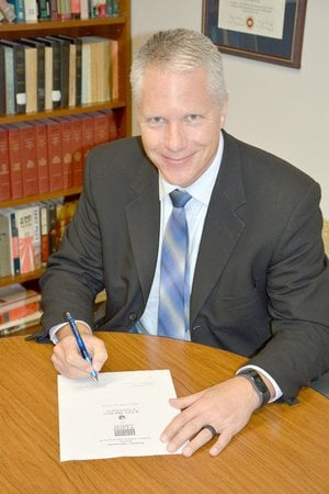 Photo submitted Dr. Ed Ericson, JBU's vice president for academic affairs, signed an articulation agreement, which gives students the opportunity to continue their educational careers by transferring courses from SAU Tech to JBU.