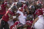 South Carolina defenders bring down Devwah Whaley (21), Arkasnas running back, in the first quarter Saturday, Oct. 7, 2017, during the game at Williams-Brice Stadium in Columbia, S.C.