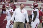 Arkansas coach Bret Bielema talks with defensive lineman McTelvin Agim prior to a game against South Carolina on Saturday, Oct. 7, 2017, in Columbia, S.C.