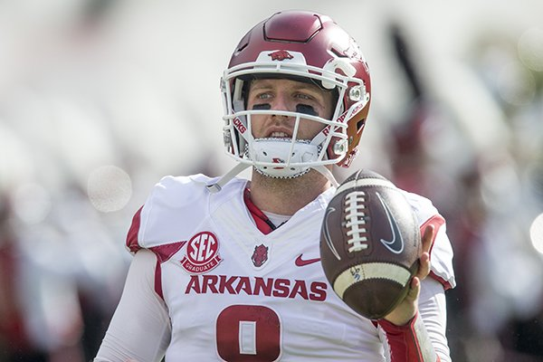 Arkansas quarterback Austin Allen warms up prior to a game against South Carolina on Saturday, Oct. 7, 2017, in Columbia, S.C.