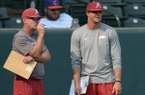 Arkansas coach Dave Van Horn (left) speaks with hitting coach Nate Thompson Tuesday, Sept. 5, 2017, during fall practice at Baum Stadium in Fayetteville.