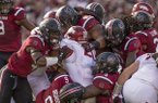 Arkansas running back Devwah Whaley is tackled by several South Carolina defenders during a game Saturday, Oct. 7, 2017, in Columbia, S.C.