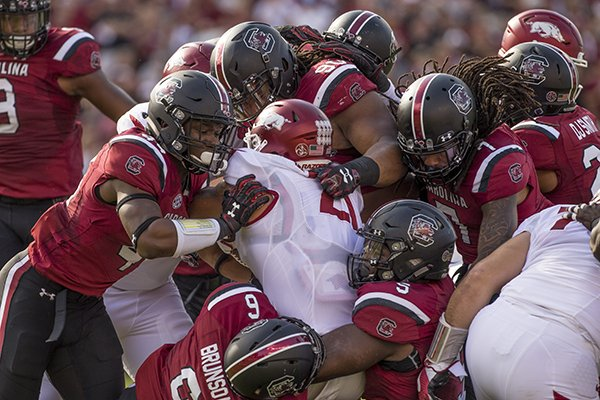 arkansas-running-back-devwah-whaley-is-tackled-by-several-south-carolina-defenders-during-a-game-saturday-oct-7-2017-in-columbia-sc
