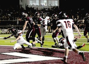 MARK HUMPHREY ENTERPRISE-LEADER Lincoln senior Braden Umberson scores the first touchdown on the new artificial turf in the south end zone at Wolfpack Stadium in the third quarter Friday, Sept. 8 on a 5-yard pass from quarterback Caleb Lloyd against Keys, Okla. Friday the Wolves defeated Berryville, 39-0. Game details are on Page 3B.