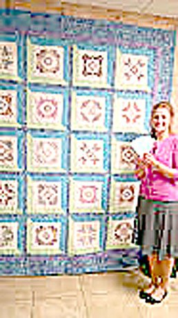 Photo submitted Rebecca Keener, who purchased tickets at Bella Vista Beauty Shop for the quilt being raffled by the Bella Vista Decorative Artists, is shown with the quilt.