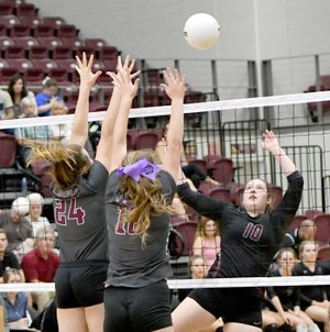 Bud Sullins/Special to the Herald-Leader Siloam Springs senior Allie Bowman, right, goes up for a hit against Huntsville's block of Destinee Harmon, No. 24, and Cori Wylie during a match on Sept. 19 at Panther Activity Center.