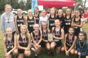 Jr. Lady Blackhawks tookfirst place in the 1A-5A meet in Springdale.