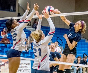 Photo courtesy of JBU Sports Information John Brown sophomore middle hitter Jessica Meyer hammers home a kill Saturday against Oklahoma Panhandle State in JBU's 3-0 win at Bill George Arena.