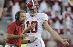 Alabama coach Nick Saban, left, talks with punter JK Scott during the first quarter of an NCAA college football game Saturday, Oct. 7, 2017, in College Station, Texas. (AP Photo/David J. Phillip)