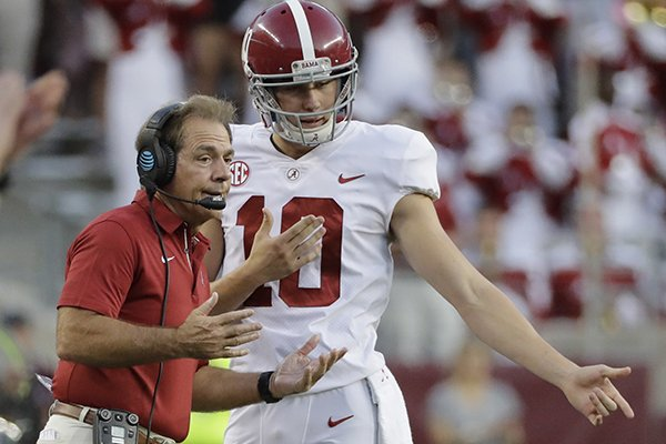 alabama-coach-nick-saban-left-talks-with-punter-jk-scott-during-the-first-quarter-of-an-ncaa-college-football-game-saturday-oct-7-2017-in-college-station-texas-ap-photodavid-j-phillip
