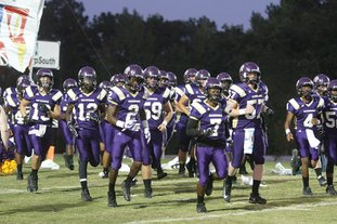 Terrance Armstard/News-Times Junction City takes the field prior to taking on Fouke last week at David Carpenter Stadium. On Friday night, the Dragons will look to stay undefeated by playing at Lake Village. The game is scheduled to begin at 7 p.m.