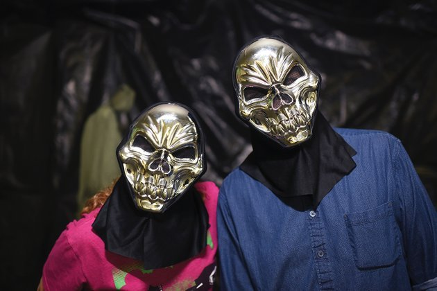 volunteers-suzanne-magouryk-left-and-david-thompson-show-off-their-masks-at-the-darkness-haunted-house-in-batesville-the-haunted-house-to-benefit-main-street-batesville-will-be-open-from-7-10-pm-oct-13-14-20-21-27-28-and-30-31