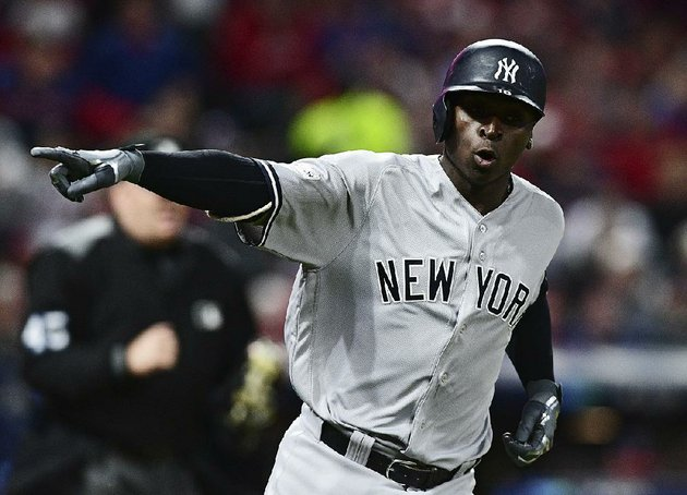 new-york-shortstop-didi-gregorius-points-to-the-dugout-wednesday-after-hitting-a-two-run-home-run-off-cleveland-starter-corey-kluber-during-the-third-inning-of-the-yankees-5-2-victory-over-the-indians-in-game-5-of-their-american-league-division-series-at-progressive-field-in-cleveland-gregorius-finished-3-for-5-with-2-runs-scored-and-3-rbi