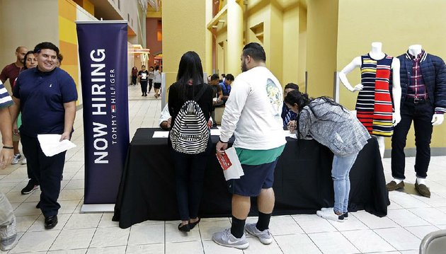 job-seekers-gather-at-a-job-fair-booth-on-oct-3-in-the-dolphin-mall-in-sweetwater-fla-august-job-openings-fell-slightly-to-just-under-61-million-the-labor-department-said-wednesday-from-614-million-in-the-previous-month