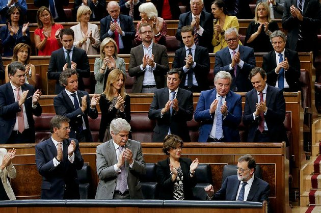 prime-minister-mariano-rajoy-bottom-right-is-applauded-by-party-members-after-his-speech-wednesday-at-the-spanish-parliament-in-madrid-rajoy-said-he-rejected-offers-of-mediation-in-the-catalonia-crisis-and-called-for-respect-of-spanish-law-a-day-after-catalan-officials-signed-what-they-called-a-declaration-of-independence-from-spain