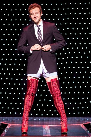 Lance Bordelon, who plays the lead role of Charlie Price in the current national tour of Kinky Boots, shows off the title footwear.