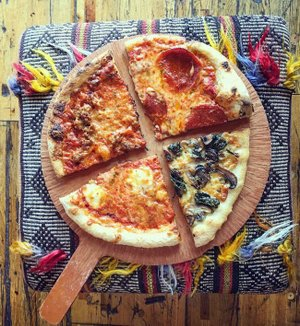 Raduno Brick Oven & Barroom is offering four of their pizzas by the slice on a revised lunch menu.