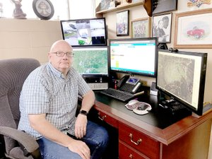 Sally Carroll/McDonald County Press Gregg Sweeten serves as McDonald County Emergency Management director, a job he's held for 35 years. Technology has aided his role over that time, but one aspect that hasn't changed is his commitment to help McDonald County neighbors during disasters.