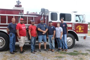 """MEGAN DAVIS MCDONALD COUNTY PRESS/Volunteers with the Southwest City Fire Department, L to R: Chief Shane Clark, Nathan Womack, Jordan Wallace, Jerry Ware, Brent """"Wormie"""" Blake, Tracy Jackson and Ron Jackson."""