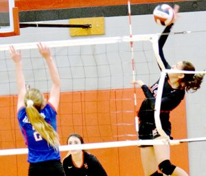 Photo by Rick Peck McDonald County's Karla Barreda attempts a spike in the Lady Mustangs' loss to East Newton on Saturday at MCHS.