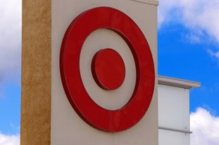 This May 3 photo shows the Target logo on a store in Upper Saint Clair, Pa. Target is jumping into voice-activated shopping as it deepens its relationship with Google, offering thousands of items found in the store except for perishables like fruit and milk. The move is happening as Google says shopping will be available later in 2017 through Google Assistant on iPhone and Android phones, joining its Google Home device and Android TV. (AP Photo/Gene J. Puskar)