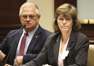 Correction Department Director Wendy Kelley testifies Wednesday, at a meeting of the Charitable, Penal and Correctional Institutions Subcommittee of the Arkansas Legislative Council in Little Rock, Ark. The panel is looking into a recent uptick in violence at the state's prisons. With Kelley is Dale Reed, the department's chief deputy director. (AP Photo/Kelly P. Kissel)