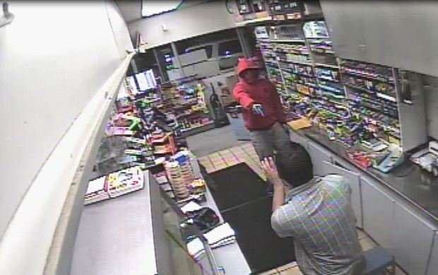 police-are-investigating-an-aggravated-robbery-where-a-man-held-a-pine-bluff-gas-station-clerk-at-gunpoint-security-footage-shows