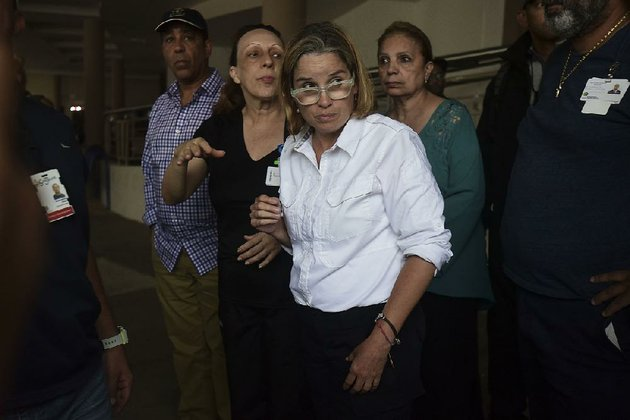 mayor-carmen-yulin-cruz-arrives-at-san-francisco-hospital-in-rio-piedras-area-of-san-juan-puerto-rico-saturday-sept-30-2017-as-about-35-patients-are-evacuated-after-the-failure-of-an-electrical-plant