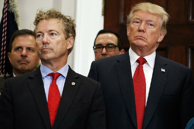 sen-rand-paul-r-ky-stands-with-president-donald-trump-after-trump-signed-an-executive-order-on-health-care-rules-thursday-paul-called-trumps-action-one-of-the-most-signifi-cant-free-market-health-care-reforms-in-a-generation-trump-gave-paul-the-pen-he-used-to-sign-the-order